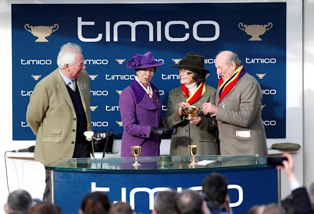 Horse Racing - Cheltenham Festival - Cheltenham Racecourse, Cheltenham, Britain - March 16, 2018 Owners Garth and Anne Broom pose with Princess Anne and the trophy after Richard Johnson rode Native River to victory in the 15.30 Timico Cheltenham Gold Cup Chase REUTERS/Darren Staples