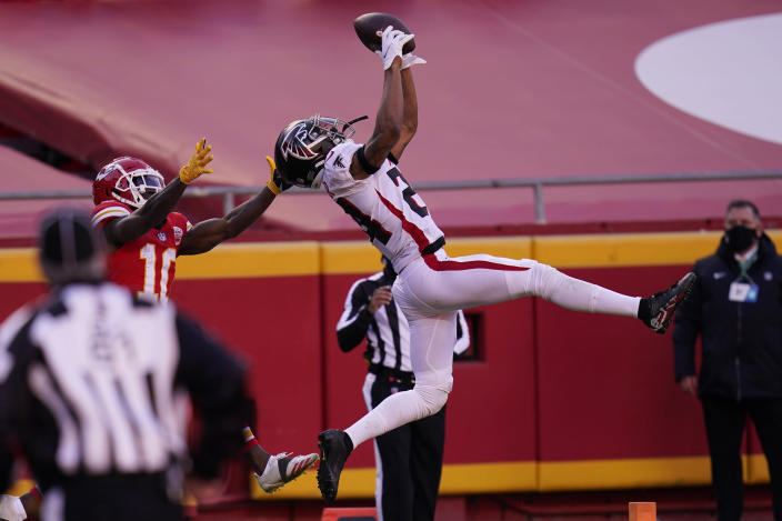 Atlanta Falcons cornerback A.J. Terrell breaks up an incomplete pass intended for Kansas City Chiefs wide receiver Tyreek Hill during the second half of an NFL football game, Sunday, Dec. 27, 2020, in Kansas City. (AP Photo/Jeff Roberson)