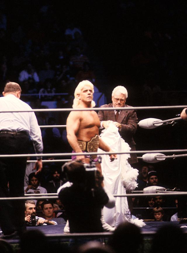 "<p>The Heavy Weigh Champion ""Nature Boy"" Rick Flair enters the ring with J.J. Dillon before the Heavy Weight bout against Road Warrior Hawk during the 1988 Bunkhouse Stampede on January 24, 1988 at the Nassau Coliseum in Uniondale, New York. (Photo by B Bennett/Getty Images) </p>"