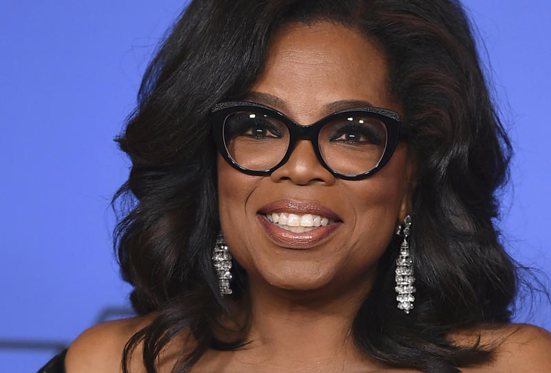Oprah Winfrey poses in the press room with the Cecil B. De Mille Award at the 75th annual Golden Globe Awards in Beverly Hills Calif. In the final days in one of the nation's hottest governor's races Oprah Win