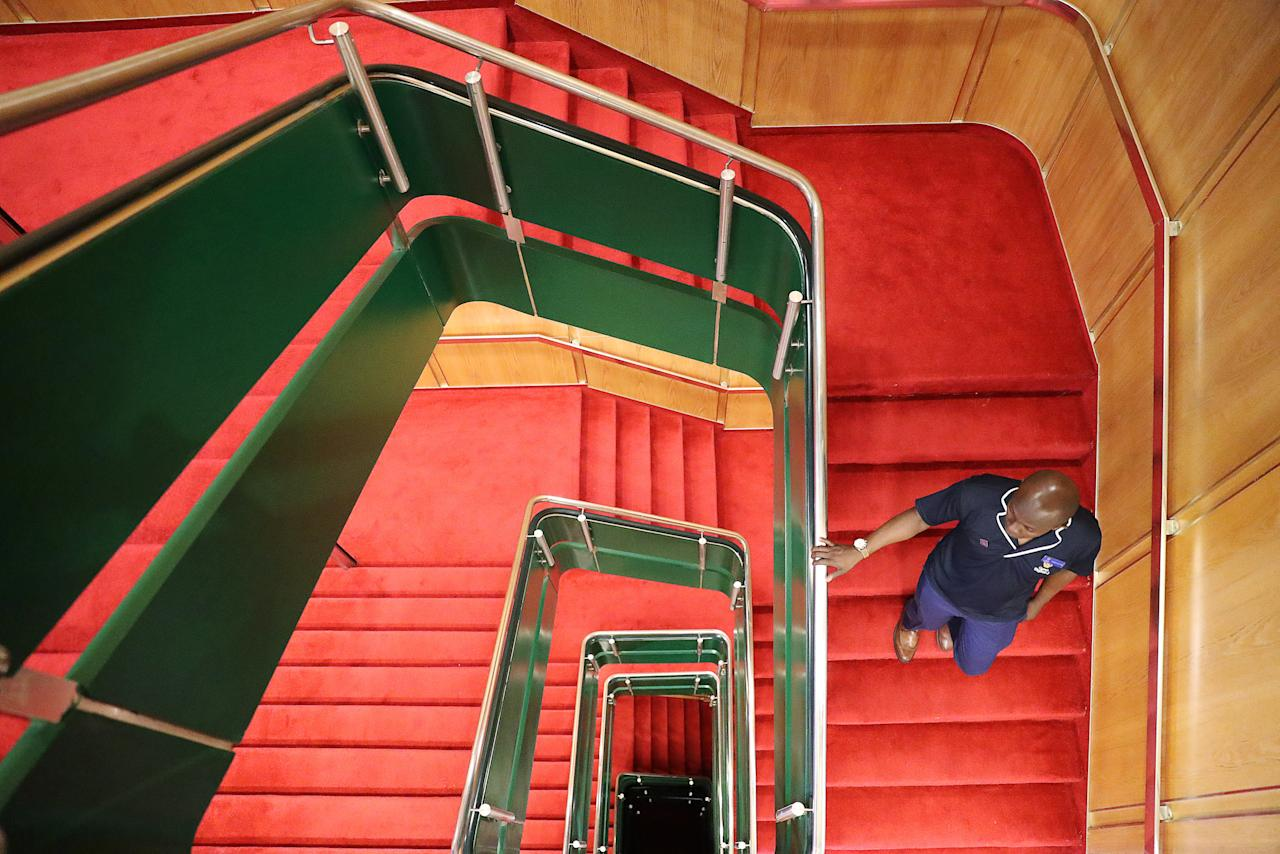 A man walks on the stairs inside the Elizabeth II cruise ship, launched as a hotel, in Dubai, UAE April 18, 2018. REUTERS/Ahmed Jadallah