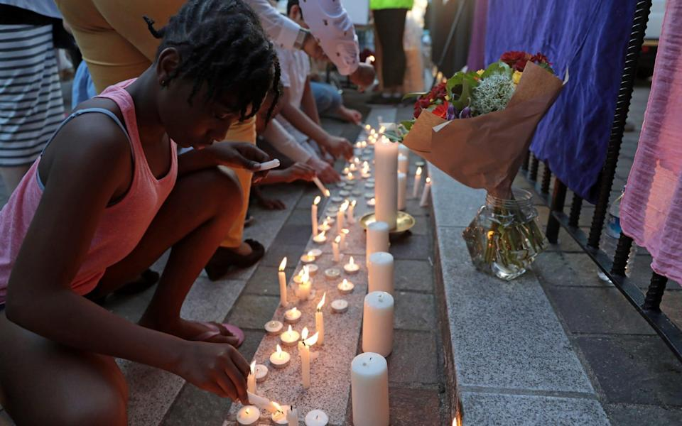 Prayers are said and candles are lit outside Notting Hill Methodist Church near the 24 storey residential Grenfell Tower block in Latimer Road - Credit: Getty