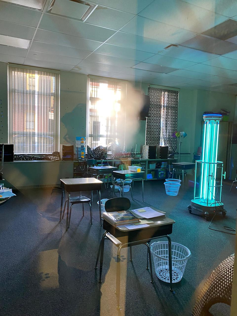 An ADIBOT sanitizes a Christina classroom, using UV-C light to disinfect surfaces and the air.