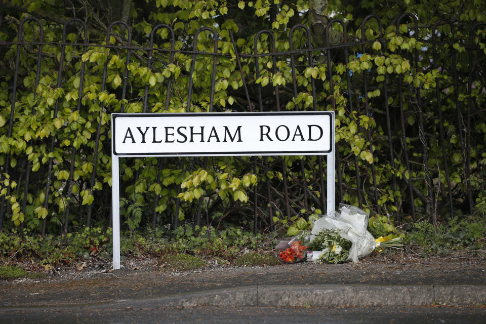 DOVER, ENGLAND - MAY 02: Floral tributes laid underneath a road sign for PCSO Julia James on May 2, 2021 in Aylesham, England.The body of PCSO Julia James, 53, was discovered in the village of Snowdown, near Dover, on Tuesday afternoon. Her Jack Russell dog, Toby, was waiting by her side. So far police have no motive or suspects for her death. She was not in uniform when she was killed. (Photo by Hollie Adams/Getty Images)
