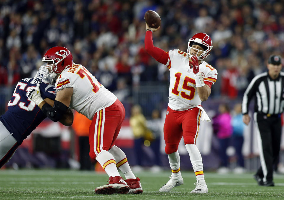 Kansas City Chiefs quarterback Patrick Mahomes (15) passes under pressure from New England Patriots linebacker Kyle Van Noy (53) during the first half of an NFL football game, Sunday, Oct. 14, 2018, in Foxborough, Mass. (AP Photo/Michael Dwyer)