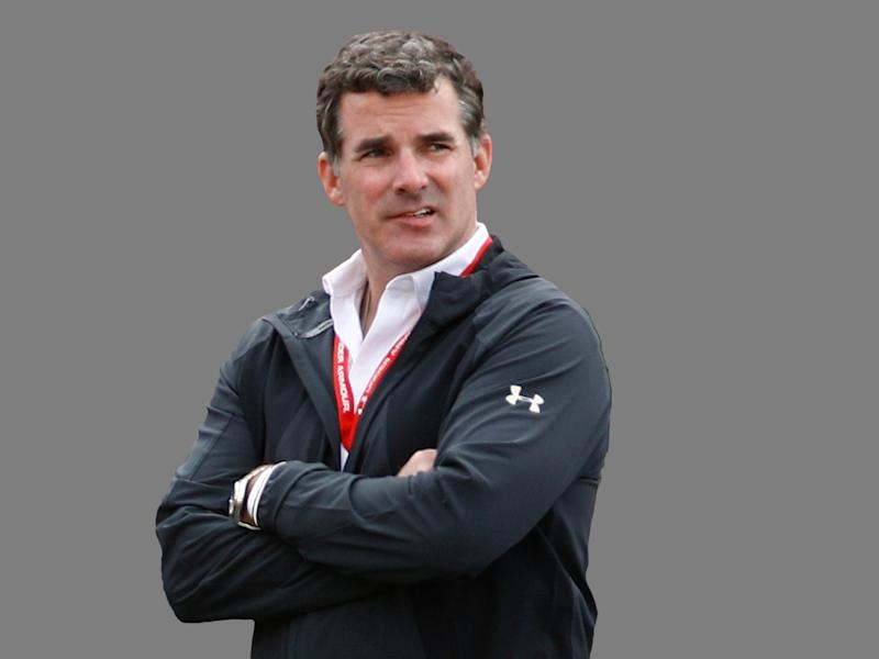 Kevin Plank headshot, as Under Armour founder and CEO, graphic element on gray
