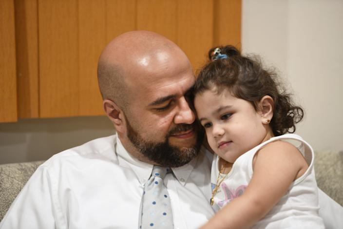 Mohamed Khairullah, mayor of Prospect Park, New Jersey, was traveling home from Turkey last month with his wife and kids when he said he was held and questioned for three hours about his work and his travel. Khairullah is pictured with his daughter, Ahid.