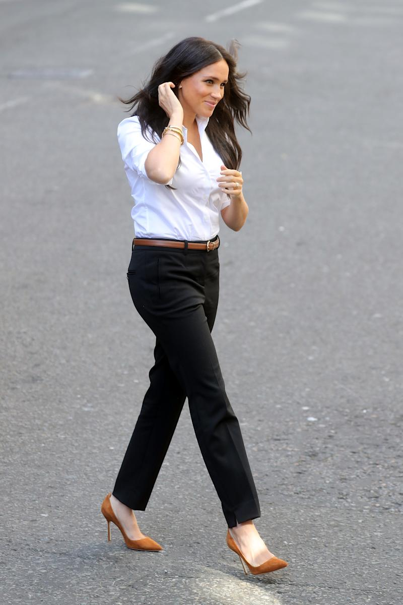 The Duchess of Sussex arrives to launch the Smart Works capsule collection [Photo: Getty Images]