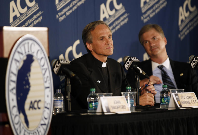 Notre Dame president, the Rev. John I. Jenkins, listens during an announcement from the Atlantic Coast Conference as North Carolina Chancellor Holden Thorp, right, listens during a news conference at the University of North Carolina in Chapel Hill, N.C., Wednesday, Sept. 12, 2012. Notre Dame is moving to the Atlantic Coast Conference _ yet keeping its football independence. The school will play five football games annually against the league's programs, but will be a full member in all other sports. The Irish will have access to the ACC's non-BCS bowl tie-ins. (AP Photo/Gerry Broome)