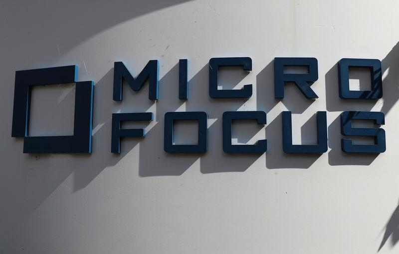 A sign stands outside the offices of Micro Focus in Newbury