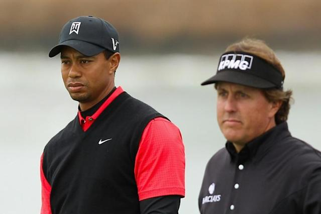 Tiger Woods and Phil Mickelson are teaming up with NFL stars Tom Brady and Peyton Manning for a made-for-TV charity golf clash on May 24 that will benefit COVID-19 relief efforts (AFP Photo/EZRA SHAW)