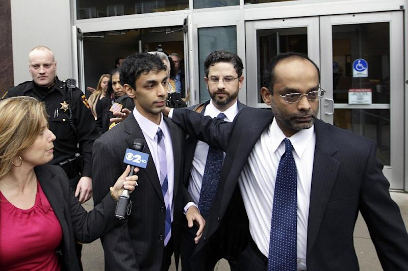 FILE - In this Friday, March 16, 2012 file photo, Dharun Ravi, center left, is helped by his father, Ravi Pazhani, right, as they leave court around noon in New Brunswick, N.J.  Defense attorney Philip Nettl is at center. An alternate juror in the trial of Ravi, convicted in a webcam spying episode that ended in his gay roommate's suicide, said he disagrees with the verdict, according to The Record newspaper, Saturday, March 17, 2012. (AP Photo/Mel Evans, File)