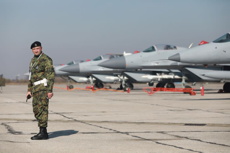 FILE PHOTO: Russian-made MiG-29 fighter jets are parked on a runway during the air show at Batajnica military airfield in Belgrade, Serbia