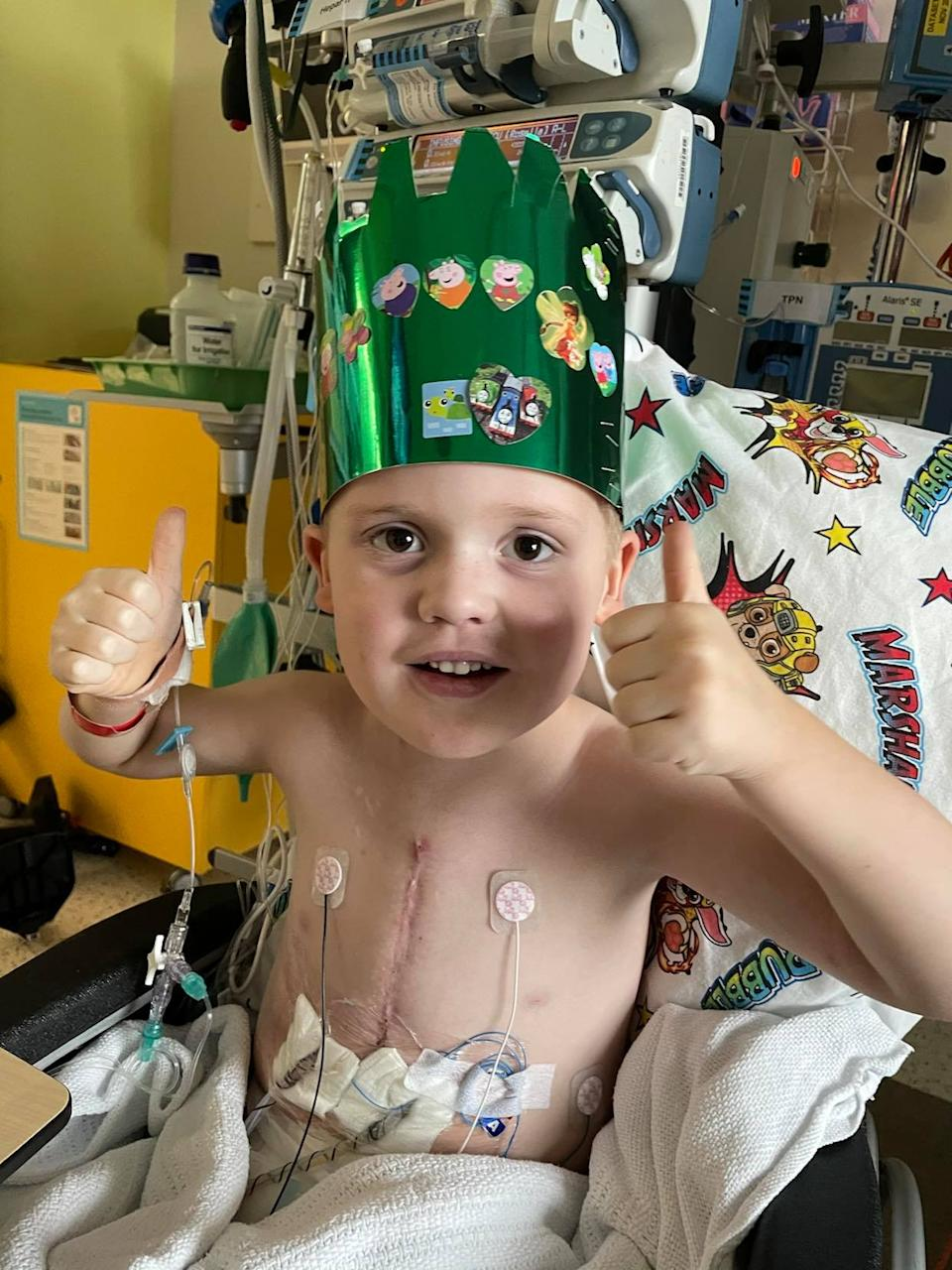 The active little boy who loves the footy in hospital. Source: Supplied