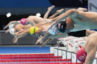 Zach Apple, of the United States, starts in a men's 100-meter freestyle semifinal at the 2020 Summer Olympics, Wednesday, July 28, 2021, in Tokyo, Japan. (AP Photo/Petr David Josek)