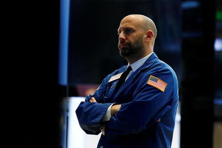 FILE PHOTO: Specialist trader Meric Greenbaum works at his post on the floor of the New York Stock Exchange (NYSE) in New York, U.S., May 17, 2017. REUTERS/Brendan McDermid