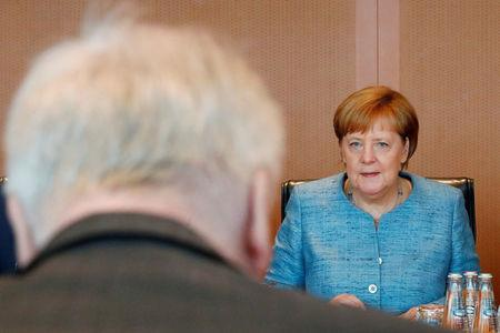 FILE PHOTO: German Interior Minister Horst Seehofer and German Chancellor Angela Merkel attend the weekly cabinet meeting in Berlin, Germany, July 6, 2018.  REUTERS/Axel Schmidt/File Photo