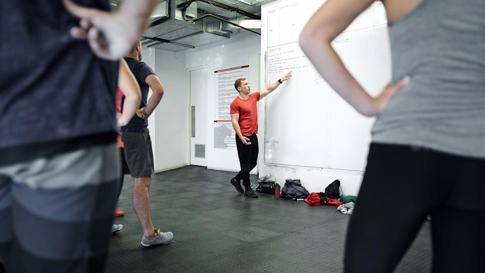 Shot of a fitness instructor working on a fitness program.