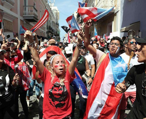 PHOTO: Protesters demonstrate against Ricardo Rossello, the Governor of Puerto Rico, near a police barricade set up along a street leading to the governor's mansion in Old San Juan, Puerto Rico, July 20, 2019. (Joe Raedle/Getty Images)