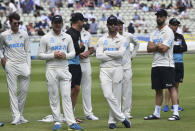 New Zealand players wait during the presentation ceremony after their win in the second cricket test match against England at Edgbaston in Birmingham, England, Sunday, June 13, 2021. New Zealand won the series 1-0. (AP Photo/Rui Vieira)
