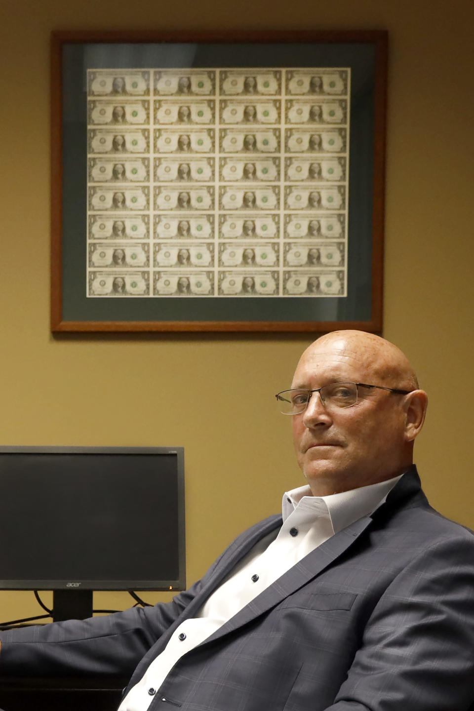 Brad Clark, President of Tompkins State Bank, poses for a portrait, Tuesday, June 15, 2021, in Galesburg, Ill. Clark says he has struggled to fill teller positions, a common theme among the local businesses his north-side branch serves and blames extended unemployment benefits that were part of the federal Covid response for encouraging workers to stay idle, and fears they are nudging inflation upward. (AP Photo/Shafkat Anowar)
