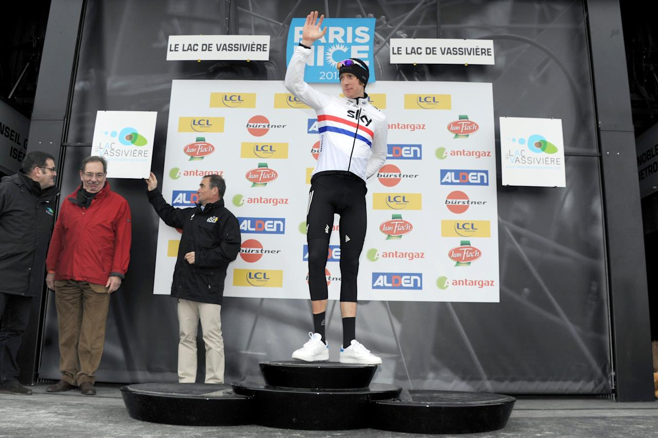 Britain's Bradley Wiggins celebrates his Yellow jersey of overall leader on the podium at the end of the 194 km and third stage of the 70th edition of the Paris-Nice cycling race run between Vierzon and Lac de Vassiviere on March 06,  2012. AFP PHOTO / PASCAL PAVANI (Photo credit should read PASCAL PAVANI/AFP/Getty Images)