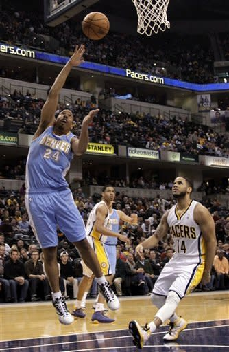 Denver Nuggets guard Andre Miller, left, shoots in front of Indiana Pacers guard D.J. Augustin during the first half of an NBA basketball game in Indianapolis, Friday, Dec. 7, 2012. (AP Photo/AJ Mast)