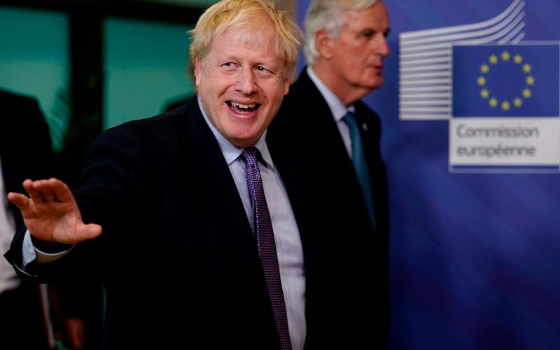 Johnson in Brussels last year. The Prime Minister has been asked to step in and help to accelerate talks - GETTY IMAGES