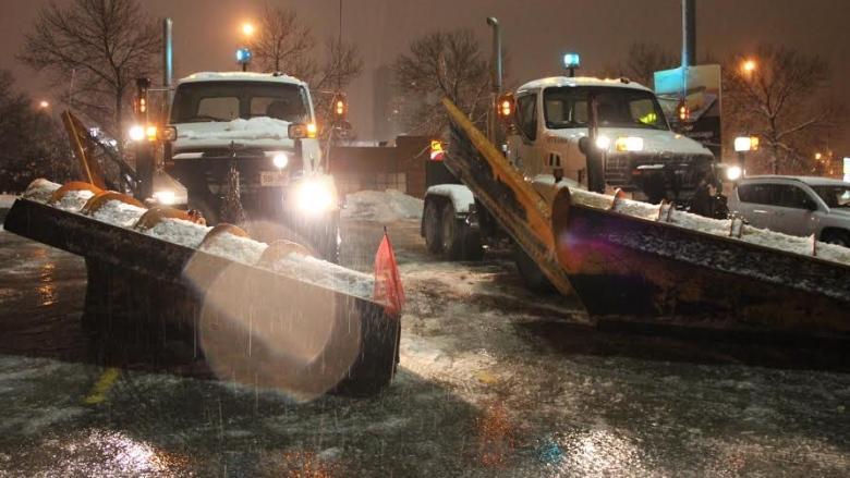 Snow plows prepare to clear slushy streets in Toronto on Monday as forecasters warn freezing rain will turn roads in much of Southern Ontario into ice paths.