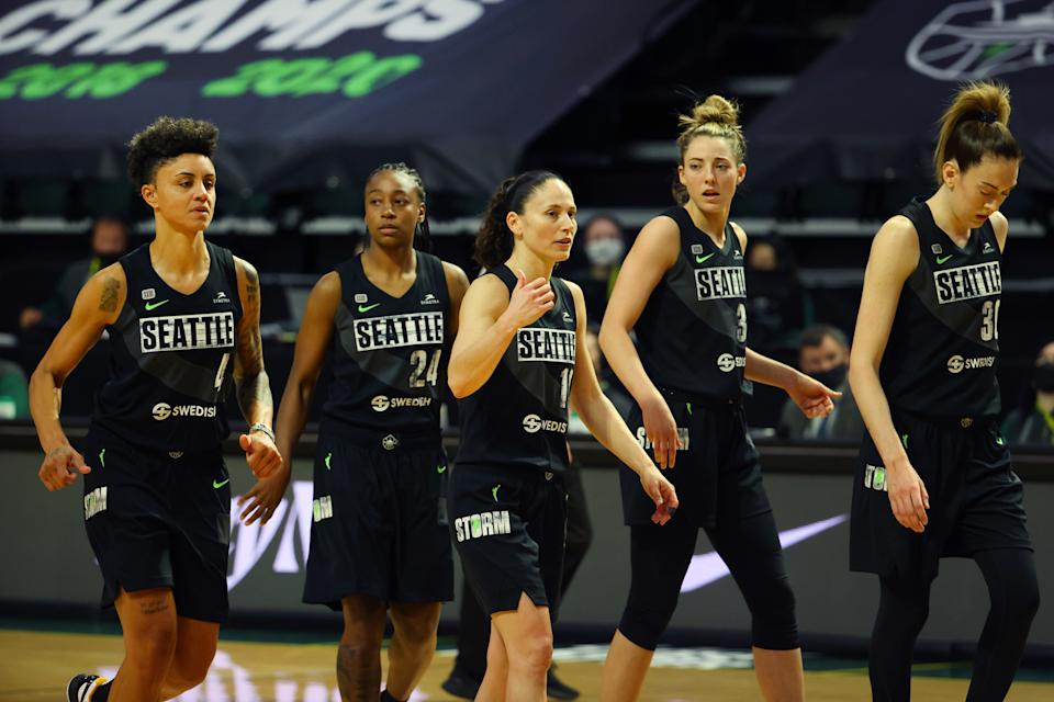 EVERETT, WASHINGTON - MAY 15: (L-R) Candice Dupree #4, Jewell Loyd #24, Sue Bird #10, Katie Lou Samuelson #33 and Breanna Stewart #30 of the Seattle Storm look on during the second quarter against the Las Vegas Aces at Angel of the Winds Arena on May 15, 2021 in Everett, Washington. NOTE TO USER: User expressly acknowledges and agrees that, by downloading and or using this Photograph, user is consenting to the terms and conditions of the Getty Images License Agreement. (Photo by Abbie Parr/Getty Images)