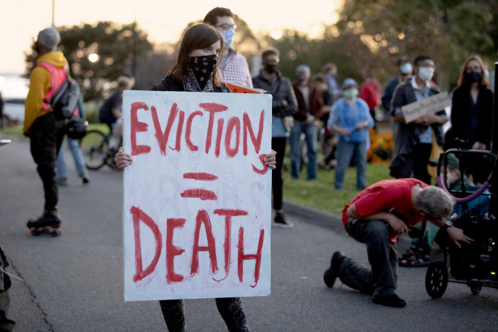 Housing activists gather in front of Gov. Charlie Baker's house on Oct. 14, 2020, in Swampscott, Mass. (Michael Dwyer / AP file)
