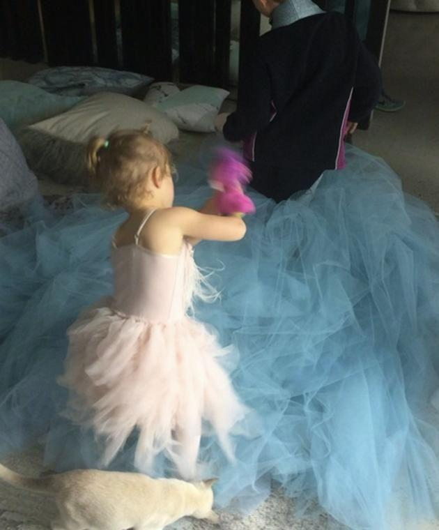 Bec Judd's two children and cat played dress-up with her couture gown.