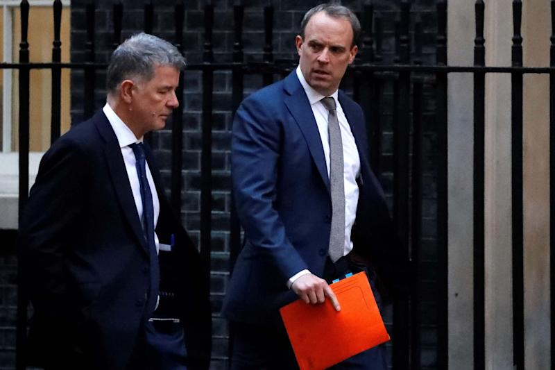 Foreign Secretary Dominic Raab (right) condemned the arrest of Mr Macaire (AFP via Getty Images)