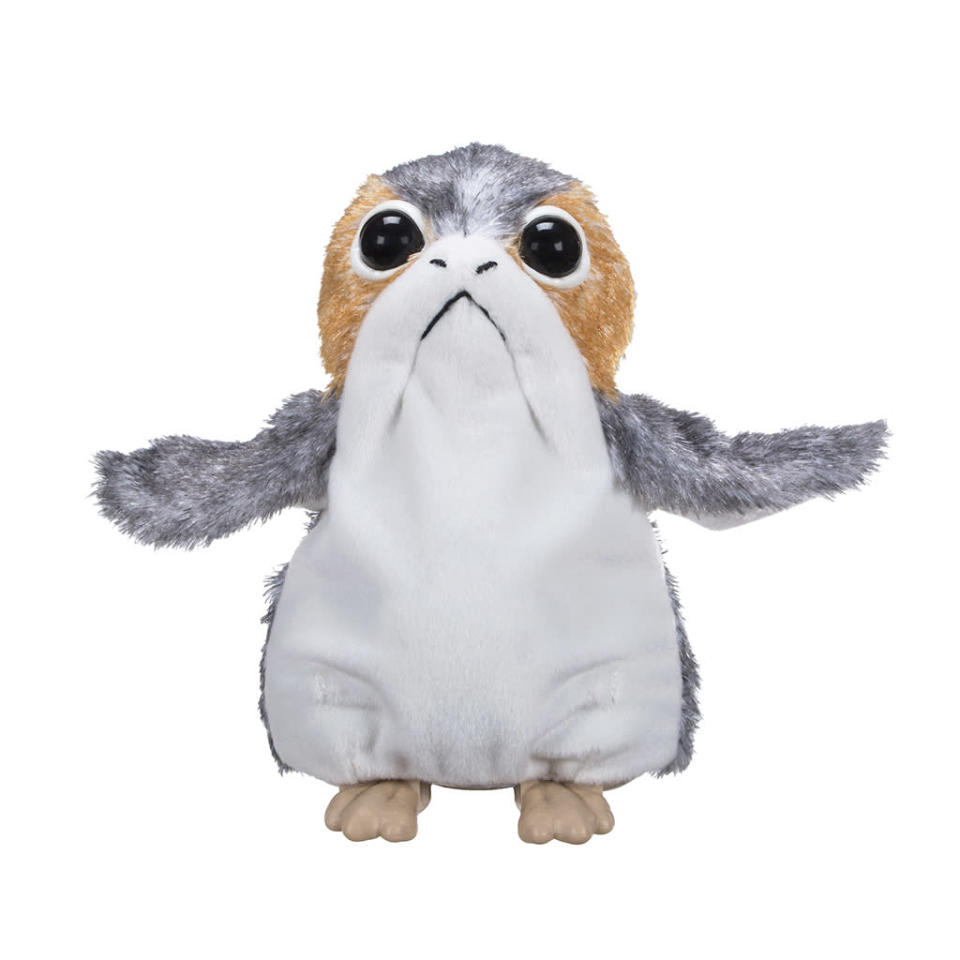 """<p>""""Imagine Porgs scurrying around their home of Ahch-To Island as they spy on Jedi Master Luke Skywalker in hiding! Befriend this small and curious creature with the Electronic Porg Plush. Inspired by <em>Star Wars: The Last Jedi</em>, this plush creature interacts and entertains <em>Star Wars</em> fans. It waves and flaps its arms as it moves and waddles. It also features authentic Porg sound effects such as tweeting, chirping, and more!"""" $39.95 (Photo: Hasbro) </p>"""