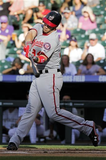 Washington Nationals' Bryce Harper hits a single off a pitch from Colorado Rockies starting pitcher Edwar Cabrera during the first inning of a baseball game on Wednesday, June 27, 2012, in Denver, Colo. (AP Photo/Barry Gutierrez)