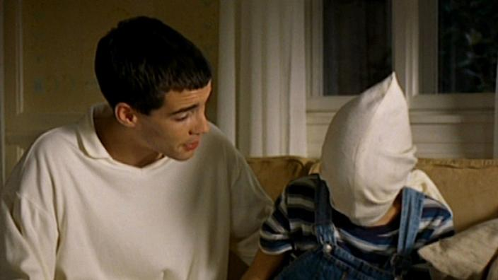 (L-R) Arno Frisch as Paul and Stefan Clapczynski as Georgie in Michael Haneke's chilling 1997 movie, Funny Games