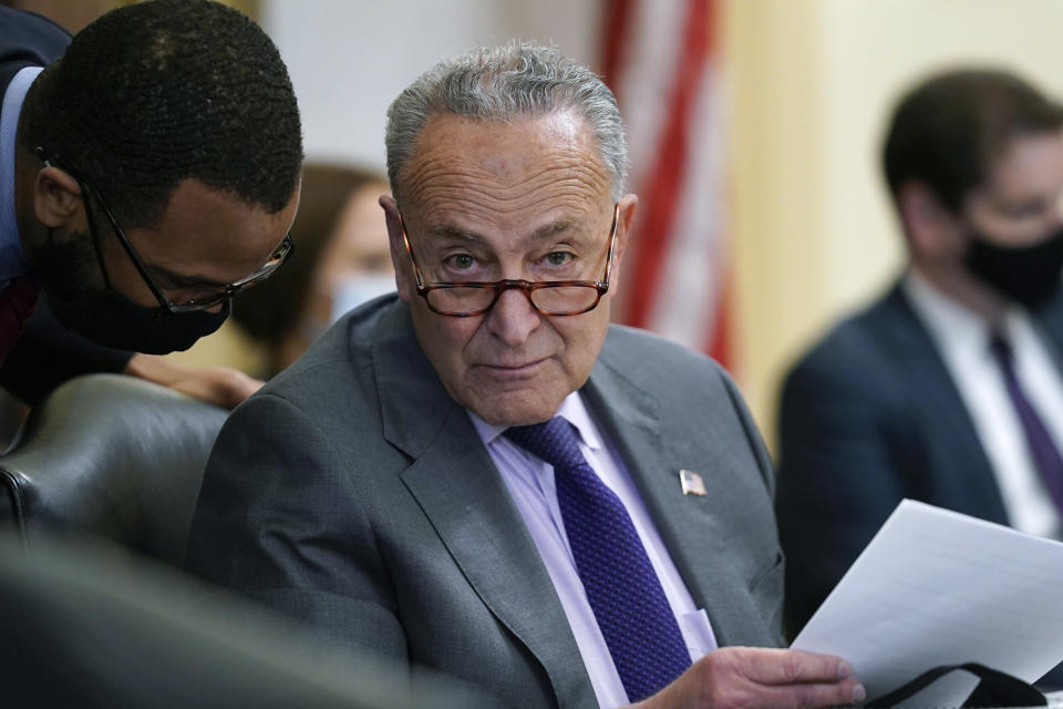 """Senate Majority Leader Chuck Schumer, D-N.Y., listens during a markup of the """"For the People Act of 2021"""" in the Senate Rules Committee, at the Capitol in Washington, Tuesday, May 11, 2021. The bill, which would expand access to voting and other voting reforms, was already passed by Democrats in the House. (AP Photo/J. Scott Applewhite)"""