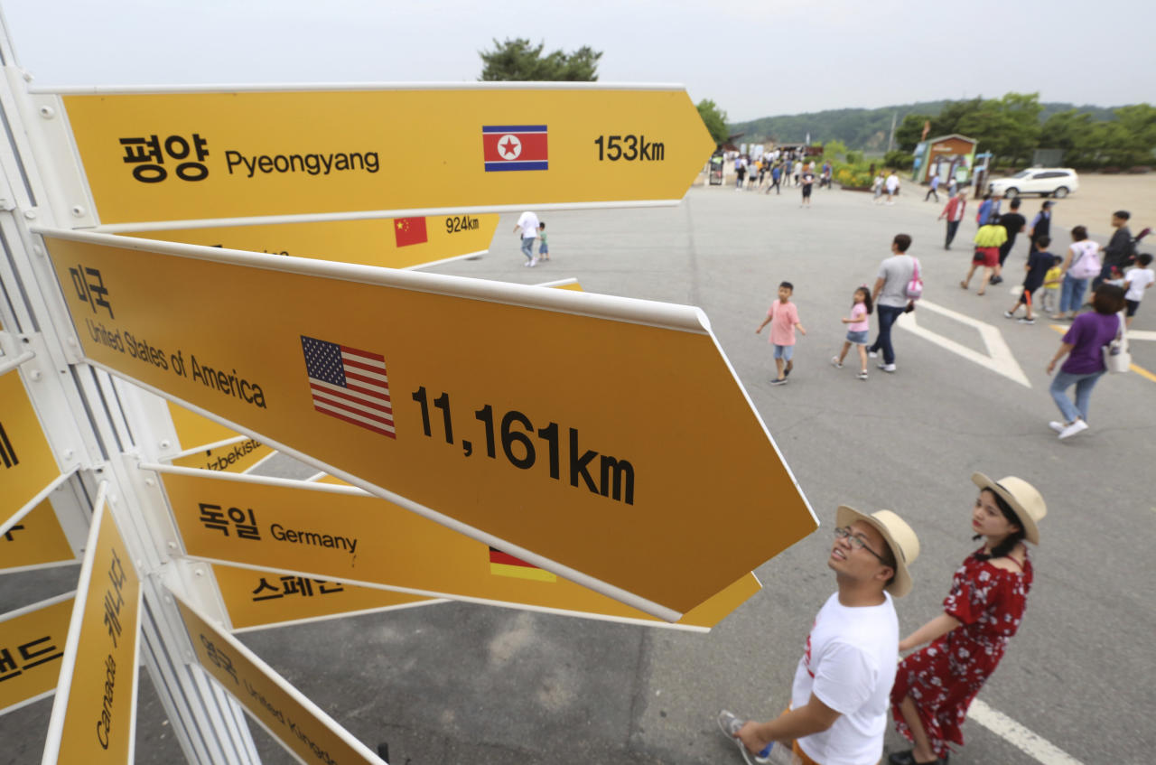 Destination signs to North Korea's capital Pyongyang, top, and the United States, center, are seen at the Imjingak Pavilion in Paju near the border village of Panmunjom, South Korea, Wednesday, June 13, 2018. While South Koreans cheered with hope and China saw an opening to discuss lifting sanctions on North Korea, some countries in Europe and the Mideast cautioned Tuesday that it was premature to judge U.S. President Donald Trump and North Korean leader Kim Jong Un's summit a success. (AP Photo/Ahn Young-joon)