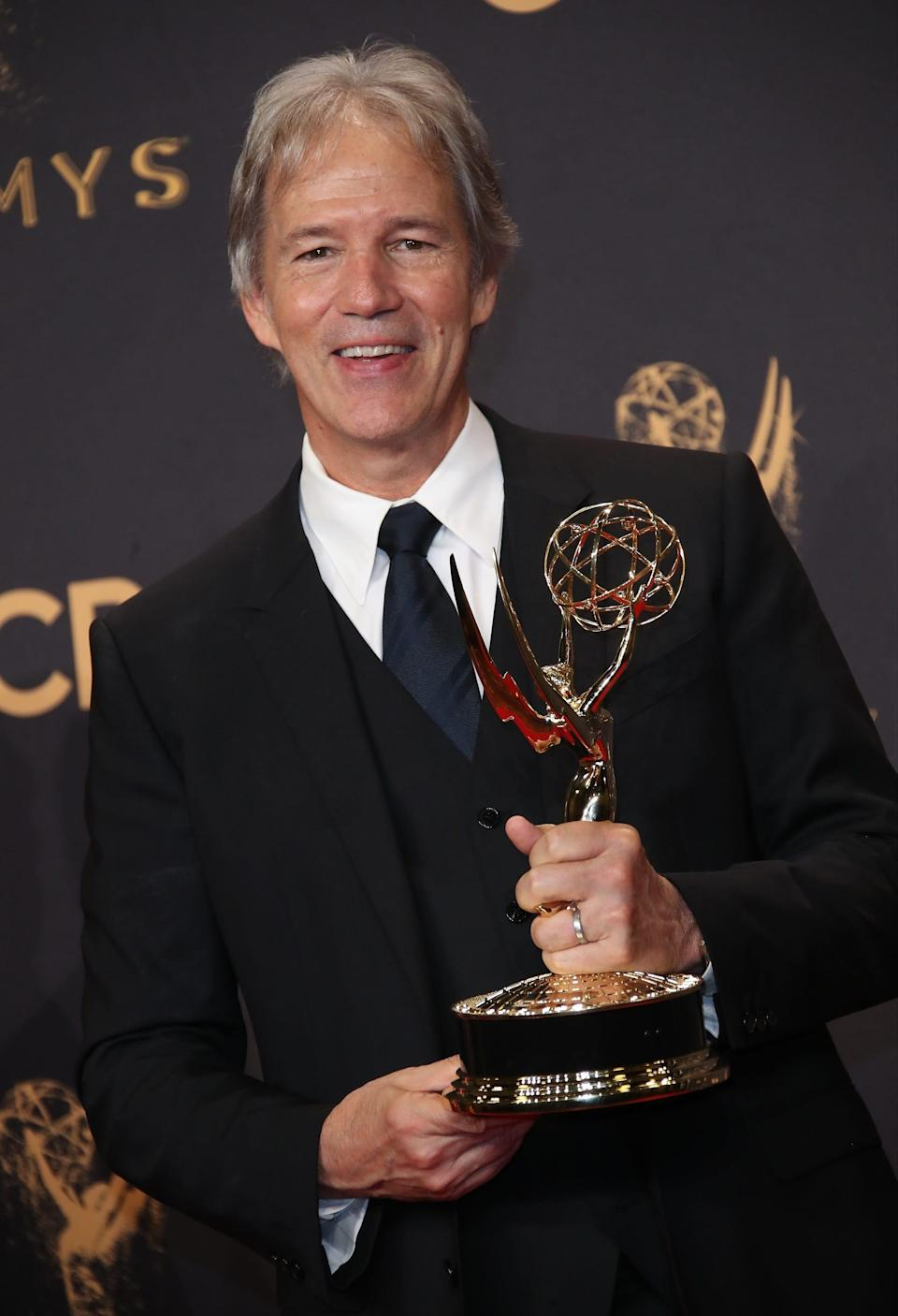 """David E. Kelley poses with his Emmy Award for outstanding limited series for """"Big Little Lies"""" in 2017."""