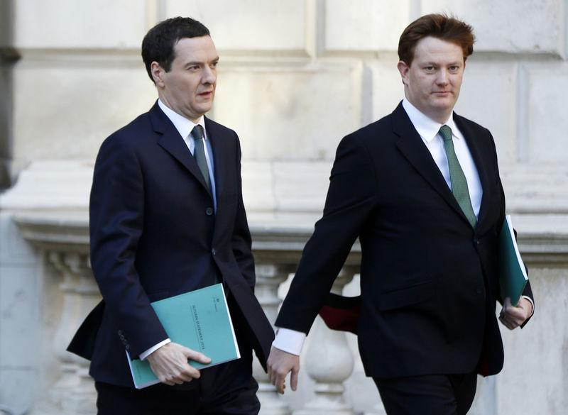 Britain's Chancellor of the Exchequer George Osborne and Chief Secretary to the Treasury Danny Alexander leave the Treasury to present the Autumn Statement to Parliament in London