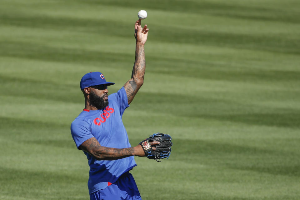 Chicago Cubs right fielder Jason Heyward throws the ball during baseball practice at Wrigley Field on Friday, July 3, 2020 in Chicago. (AP Photo/Kamil Krzaczynski)