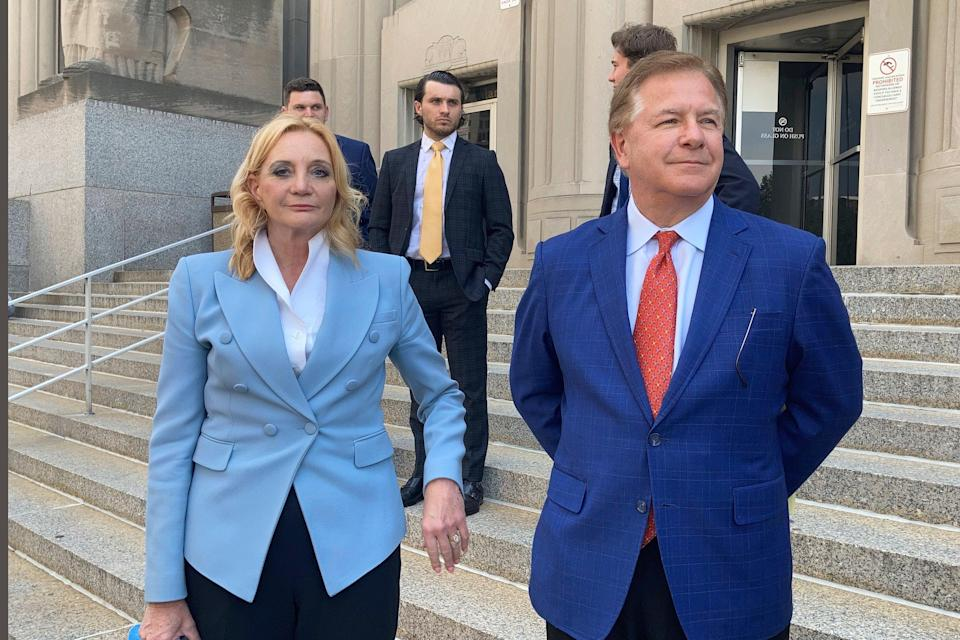 Patricia McCloskey, left, and her husband Mark McCloskey outside court on Thursday (AP)