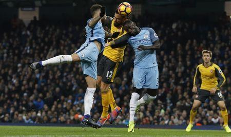 Arsenal's Olivier Giroud in action with Manchester City's Bacary Sagna and Nicolas Otamendi
