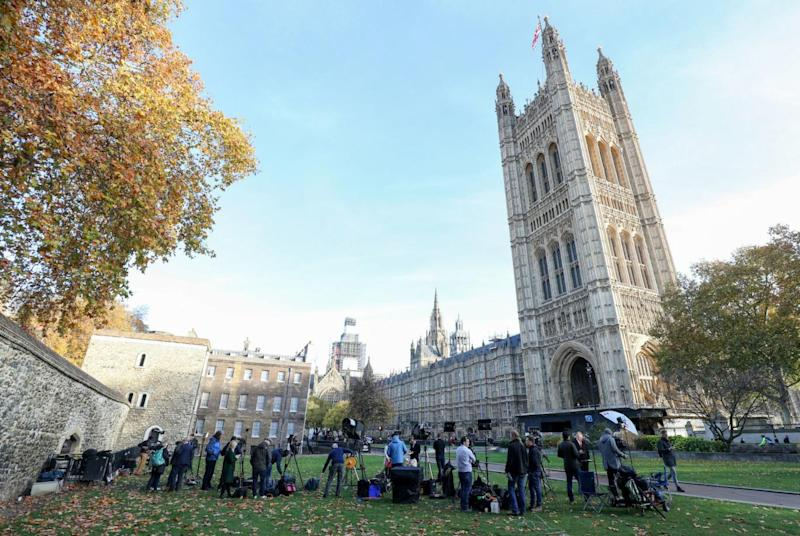 Media gather on College Green next to the Houses of Parliament on Wednesday, ahead of Ms May's crunch Brexit talks (Andrew Matthews/PA)