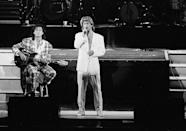 <p>In this April 7, 1985, photo, George Michael and Andrew Ridgeley of the British group WHAM! perform during a concert in Beijing. (Photo: AP/File) </p>