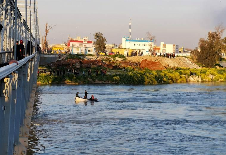 Ferry packed with Iraqis celebrating holiday sinks; 94 die