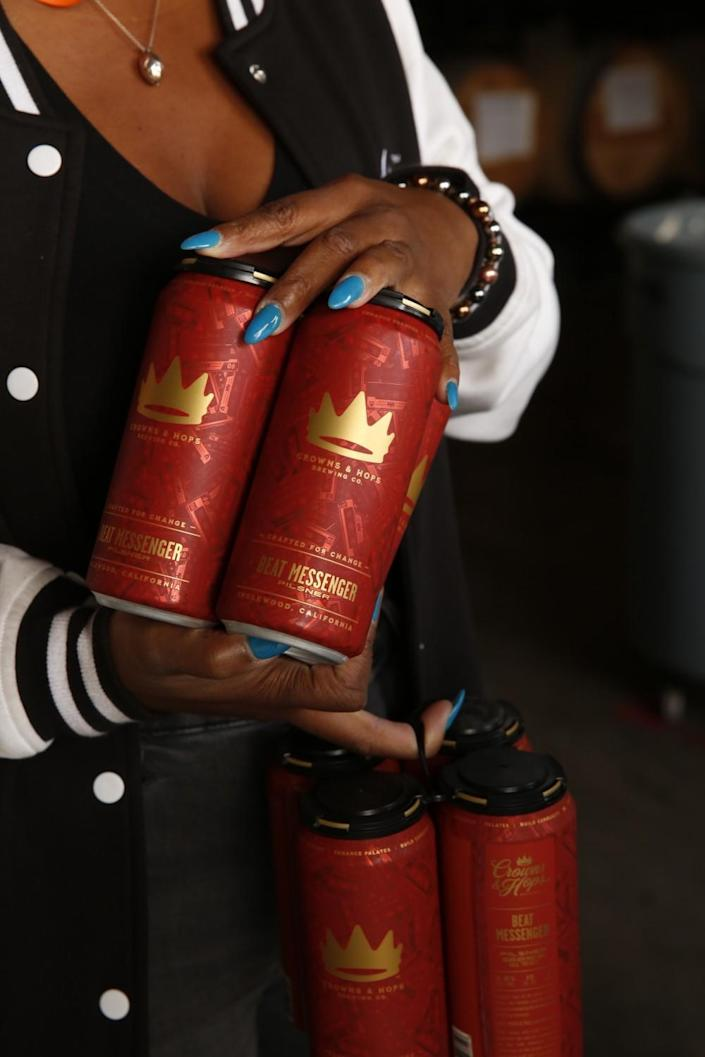 Cans of beer produced by Crowns & Hops Brewing Company.