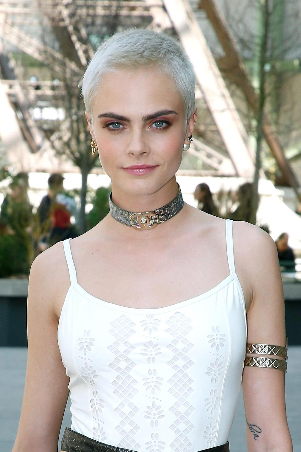<p>Delevingne's trick to growing out a buzz cut? Dye it an icy shade of blond, of course.</p>