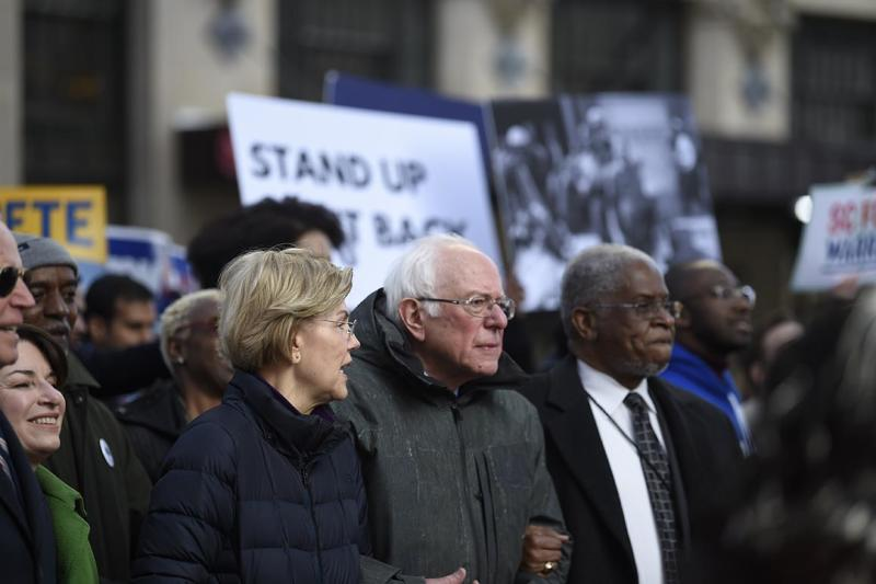 Democratic presidential candidates Elizabeth Warren and Bernie Sanders chat during a Martin Luther King Jr. Day march on Monday, Jan. 20, 2020, in Columbia, S.C. (AP Photo/Meg Kinnard)