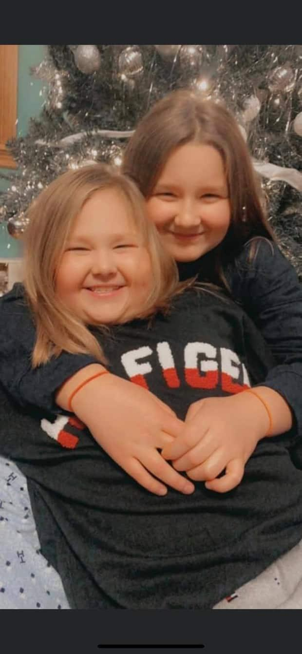 Sophia Newman, left, with sister Kylie.